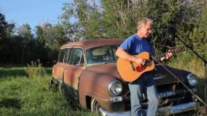 Chuck Suchy-by car